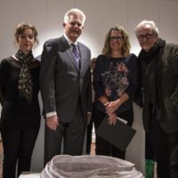 "Judges Dr Petra Kayser, Rev Tom Elich, Mandorla Art Award Winner Megan Robert and judge Prof Ted Snell with Megan's work ""The Bread Basket at Emmuas – then Flesh returned to Word"""